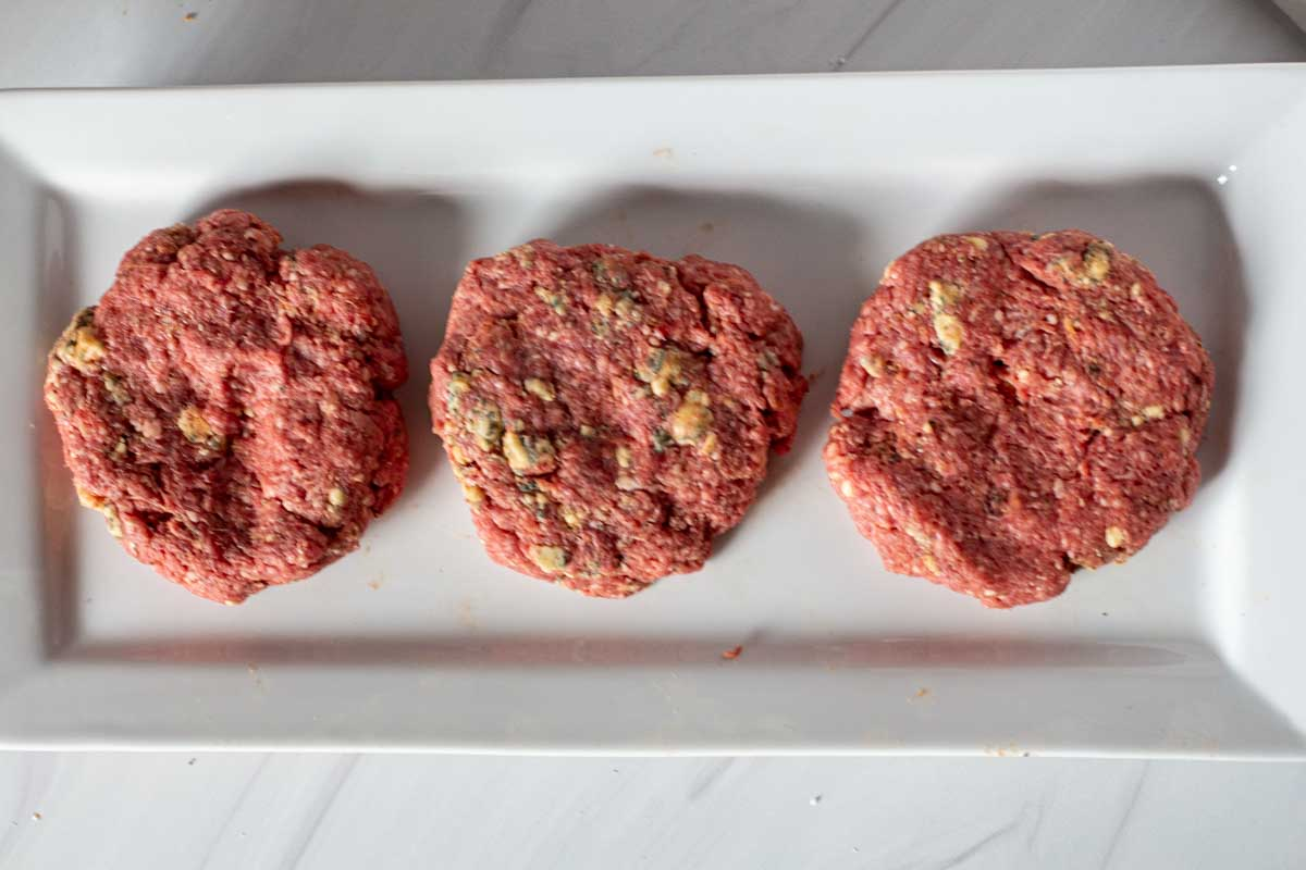 Blue cheese burger patties ready to cook.
