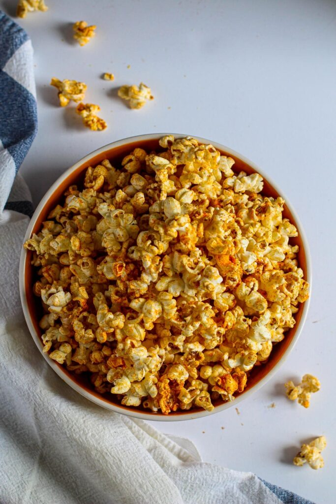 A bowl of homemade popcorn with spicy seasoning for how to cook stovetop popcorn