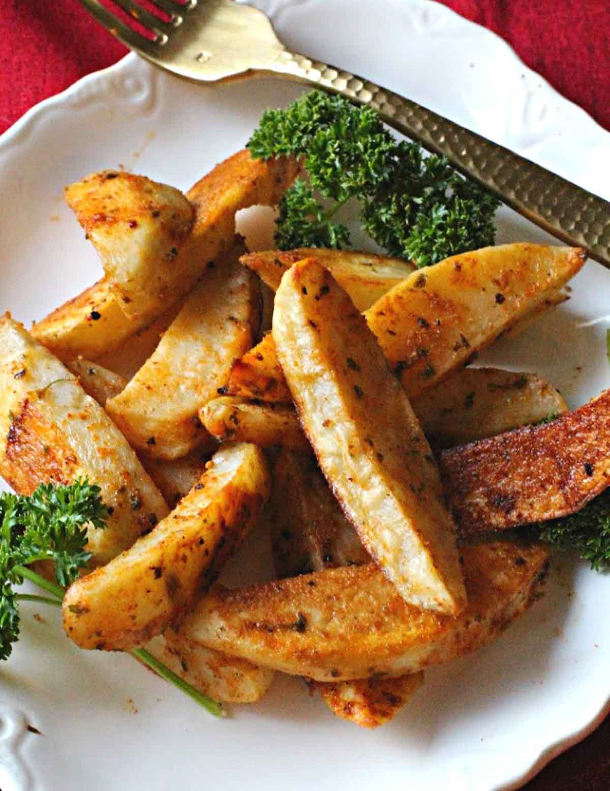 oven baked steak fries seasoned with paprika and garnished with parsley