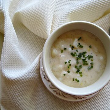 A bowl of easy cheesy potato soup made with camembert cheese and cottage cheese