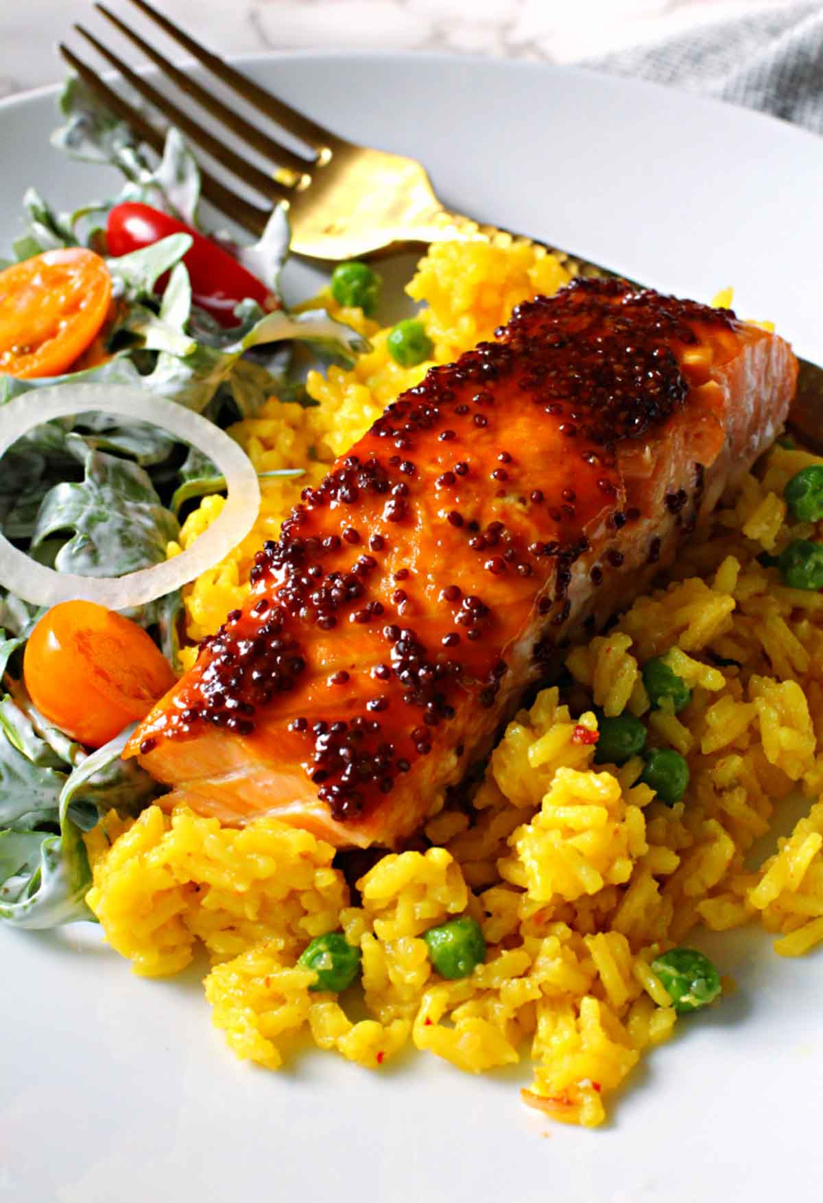 Salmon fillet glazed with maple syrup and dijon country mustard. Served over yellow rice and sided with a tossed salad with buttermilk ranch dressing