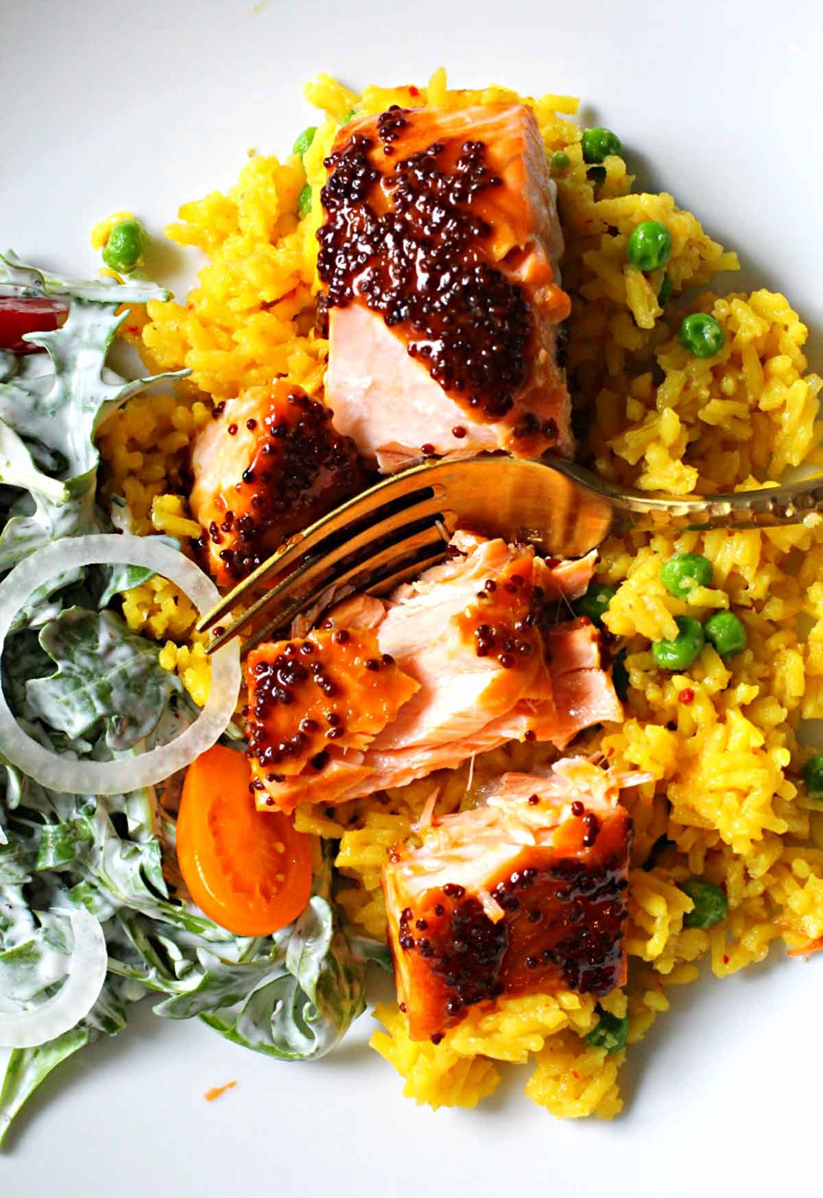 Salmon fillets glazed with maple mustard served over yellow rice and a side salad tossed with buttermilk ranch dressing