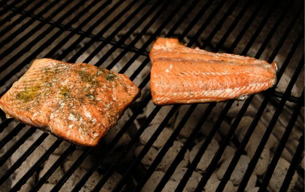 cooking salmon fillets on a grill