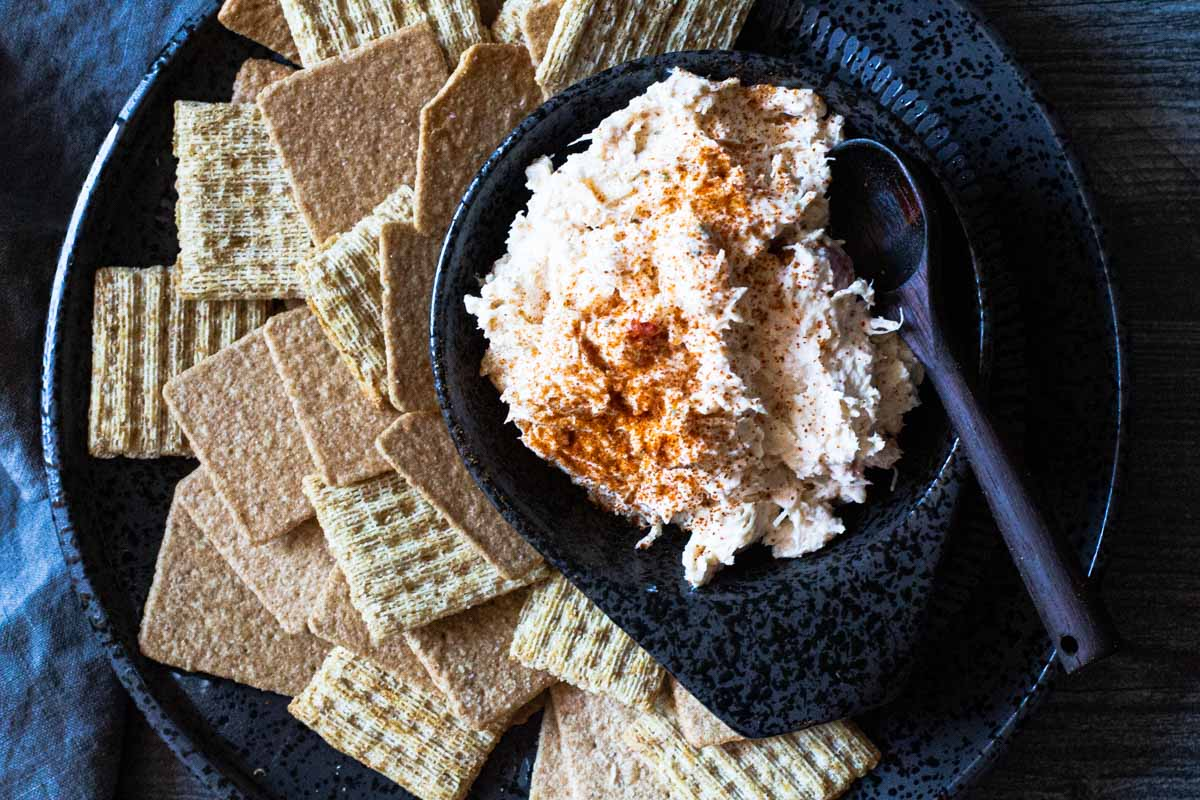 Chicken appetizer spread using canned chicken served with crackers.