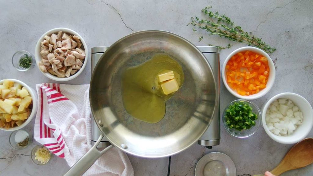 Melting butter to make chicken hash