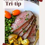 oven baked tri-tip roast served with peas and potatoes
