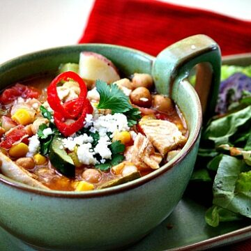 Sopa Ranchera Soup. Ranch Style Mexican Chicken Soup in a green Frankoma soup bowl