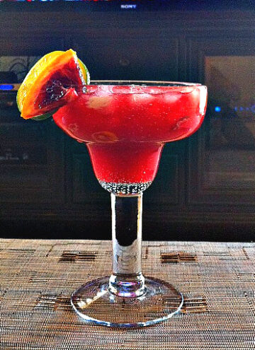 Blood Orange Margarita with Cointreau and garnished with slices of blood orange
