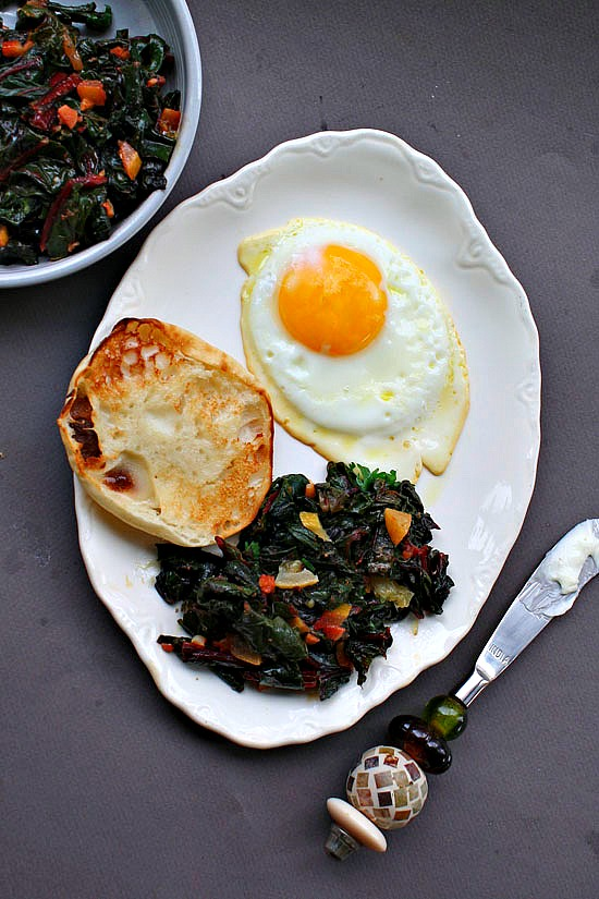 Swiss chard with fried eggs. Greens with fried egg