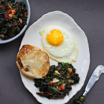 Swiss chard and fried egg with an english muffin