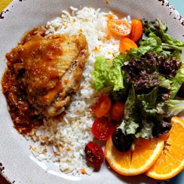 Braised Tangerine Chicken thighs with rice and tossed salad