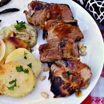 Grilled Pork Tenderloin with Southwestern Zinfandel glaze with a side of sliced potatoes