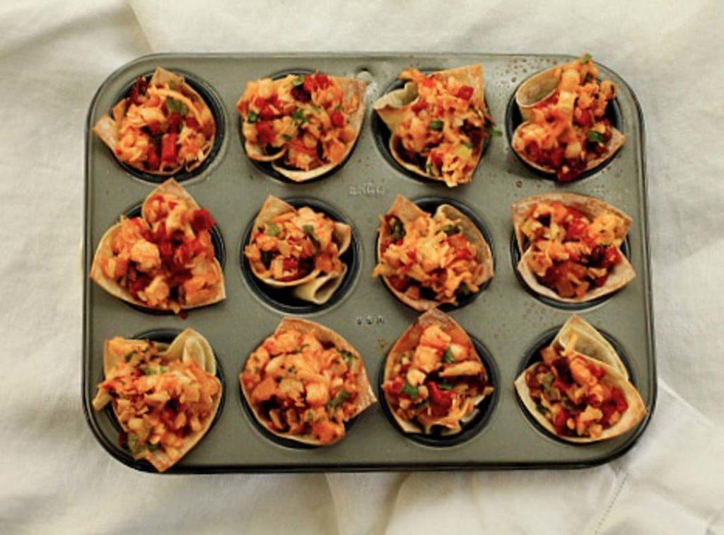 baked shrimp wonton cups in a mini muffin tin