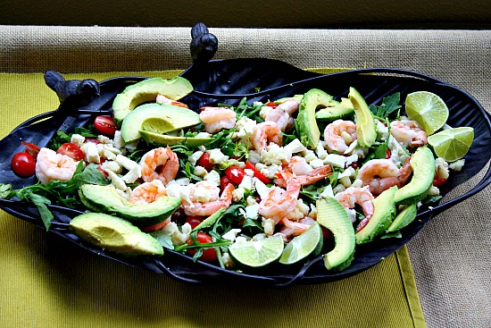 Hominy salad recipe with shrimp, avocado, arugula, tomatoes and southwestern citrus dressing