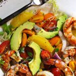 grilled shrimp salad with avocado, orange and tomatoes