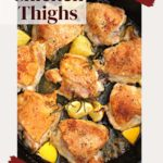 Chicken thighs cooked in a cast iron skillet with garlic and rosemary