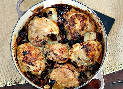 Chicken thighs cooked with porcini mushrooms and potatoes in a Le Creuset Dutch Oven.