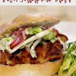 buttermilk fried chicken sandwich topped with jalapeno cabbage slaw on a hamburger bun