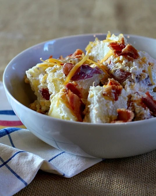 Perfect potato salad for a picnic. Loaded Potato Salad with bacon and cheese.