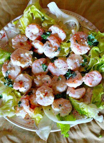 Shrimp remoulade blanc. Served on a bed of lettuce.