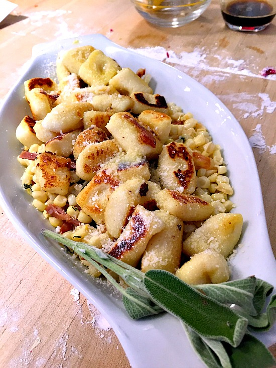 Traditional potato gnocchi with sweet corn and sage