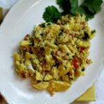 Mexican scrambled eggs with jalapeno, tomato and onion
