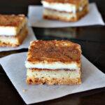 Churros Cheesecake Bars, a wonderful creamy cinnamon treat on a shortbread crust. A great dessert recipe for a Mexican meal.