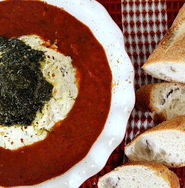 Cream cheese is just one in a lineup of this baked cheese appetizer with Marinara sauce.