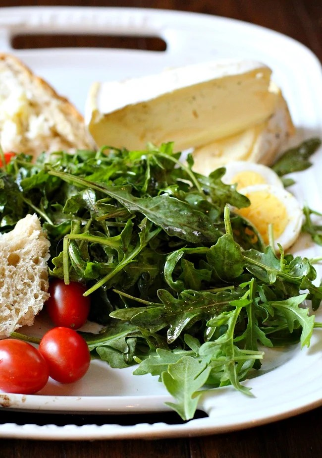 Arugula Salad with Truffle Vinaigrette. Truffle Oil and Balsamic Vinaigrette. Adding double cream cheese, bread and sliced hard boiled eggs makes this a light Summer meal.