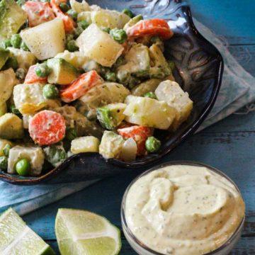 Avocado potato salad with carrots and peas.