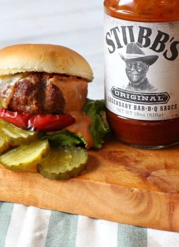 Stubbs BBQ Sauce burger recipe. Chorizo and bison burger with smoky BBQ cream sauce and caramelized red bell pepper rings.