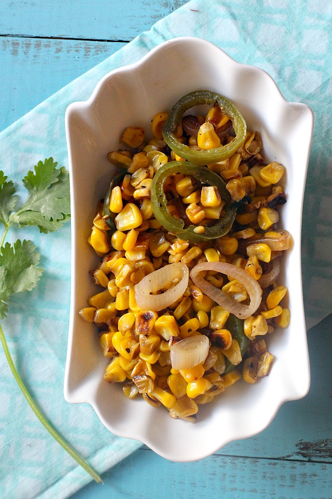 Sweet Corn sauteed in butter until browned and caramelized. With rings of shallots, jalapeno pepper, and lime juice, this is a great Mexican Sweet Corn Recipe.