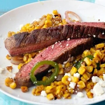 Mexican Flavored Corn topped with Grilled Flank Steak is an easy and healthy Summer meal.