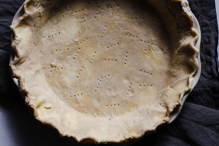 A homemade pie crust that's been docked with a fork.