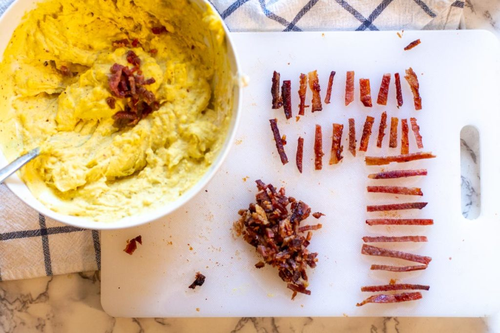 slicing bacon to make football deviled eggs