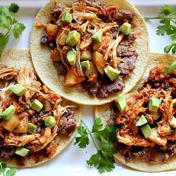 Easy slow cooker Mexican chicken dinner idea. Crock pot chicken tinga de pollo poblano