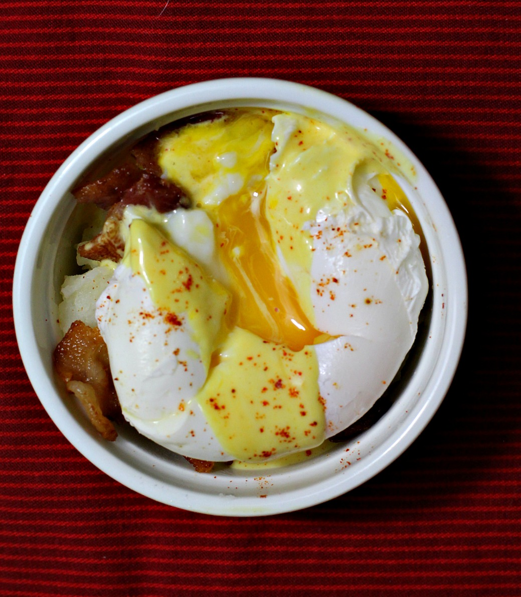 Mashed potatoes ramekins with bacon and poached eggs.
