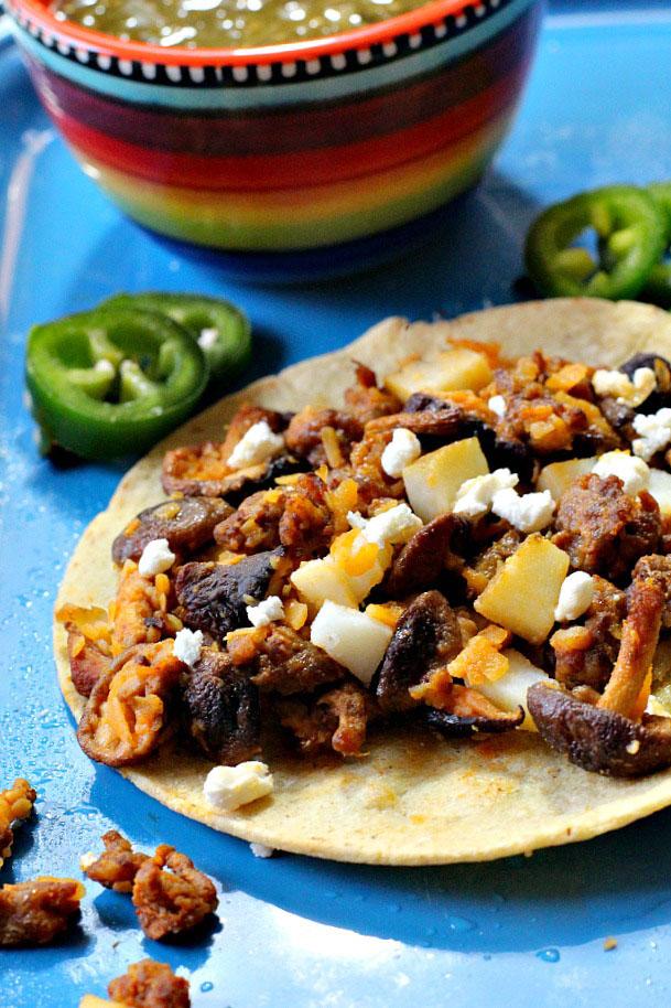 Easy chorizo potato shiitake mushroom tacos on soft corn tortillas.