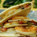 A Shrimp Appetizer with a Southwestern Touch. These Green Chile Shrimp Quesadillas are seasoned with New Mexico Red Chile Powder, mixed with Hatch Green Chile and folded into a cheesy flour tortilla.