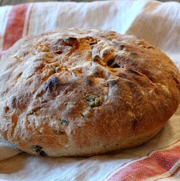 A loaf of Olive Rosemary bread. A beautiful homemade bread recipe. Salty olives, savory with rosemary. A nice crust and chewy on the inside.