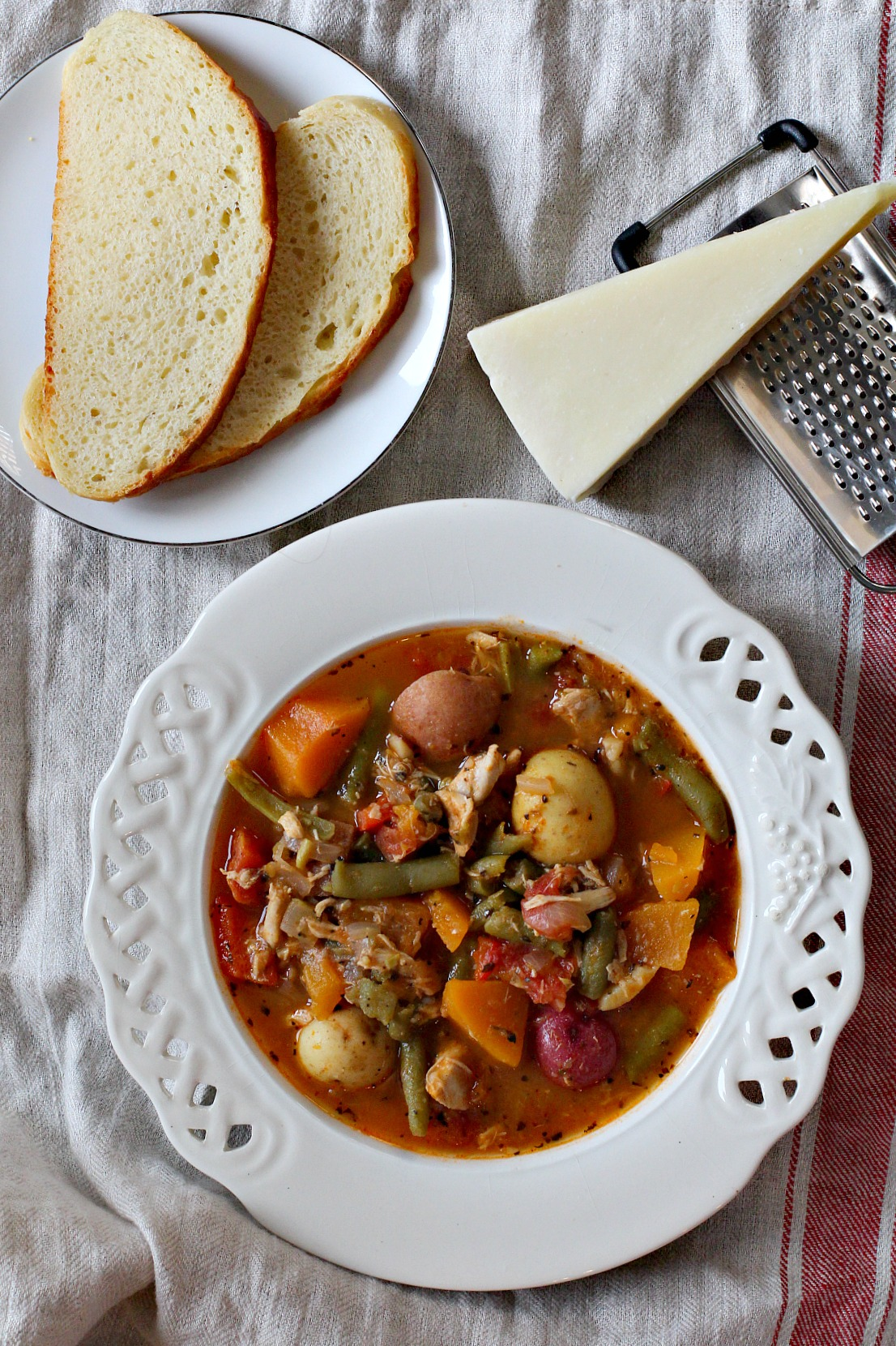 Chicken potato soup with vegetables with parmesan cheese and bread