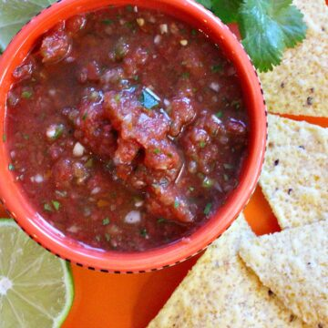 Mexican restaurant style salsa with corn chips for dipping
