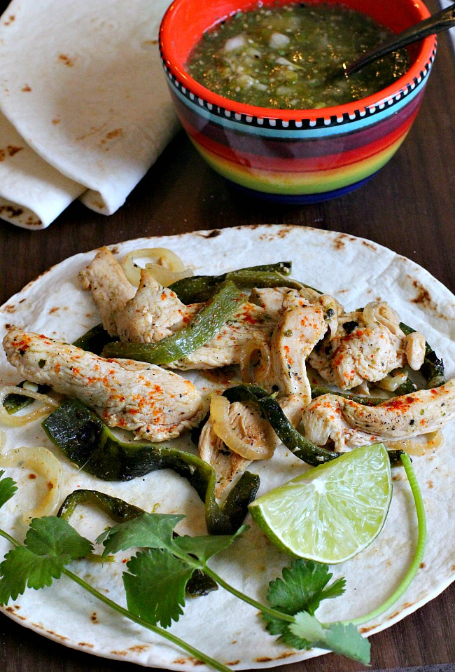 Green chili soft chicken tacos on a soft flour tortilla, poblano peppers, lime and tomatillo salsa.
