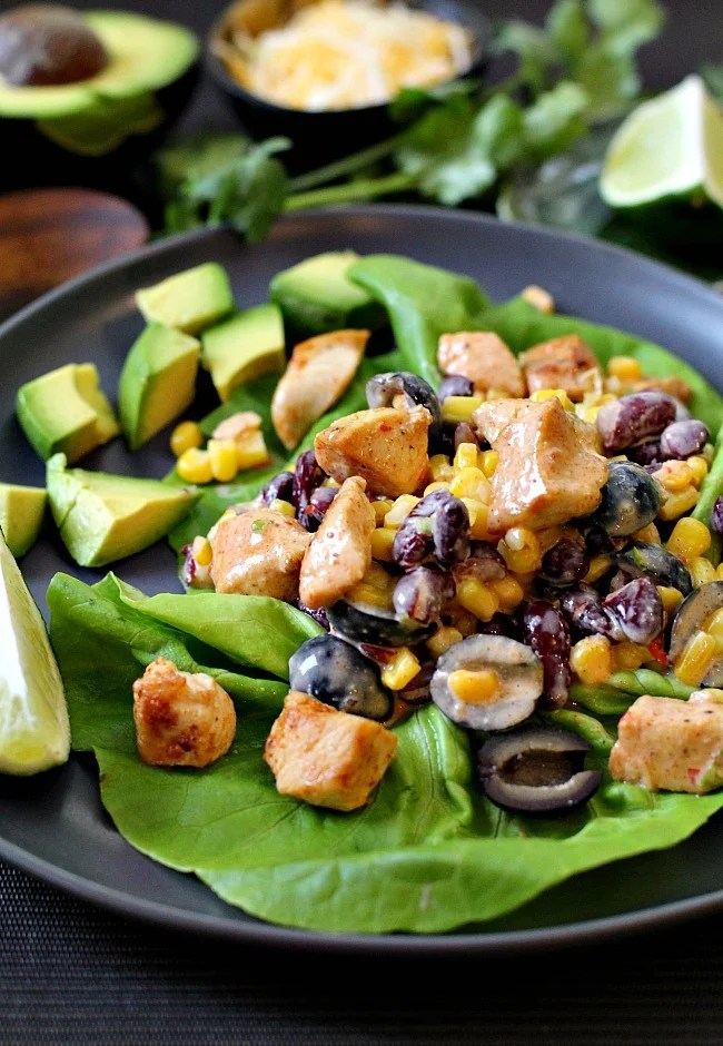 Mexican salad recipe served on Bibb Lettuce, with chicken breast, black olives, corn and kidney beans.