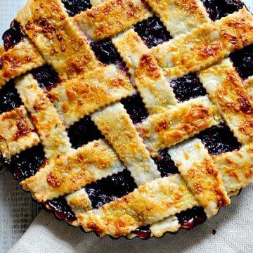 Fresh cherry pie with homemade lattice pie crust in a 9 inch tart pan.