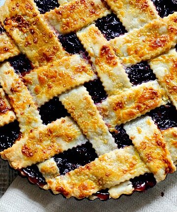 Fresh cherry pie with homemade lattice pie crust in a 9 inch tart pan.