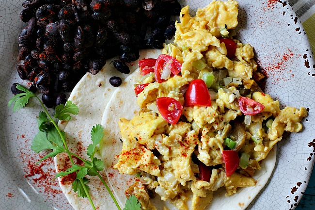 Mexican breakfast Scrambled eggs with tomatoes, celery, onion, sugar and vinegar served on a flour tortilla