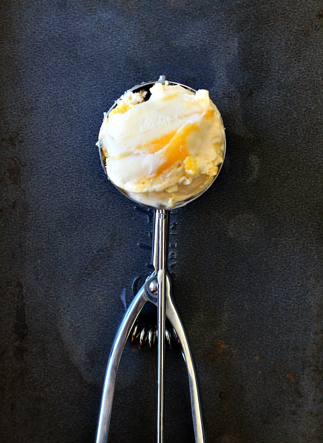 Homemade Vanilla Lemon Curd Ice Cream in an Ice Cream Scoop