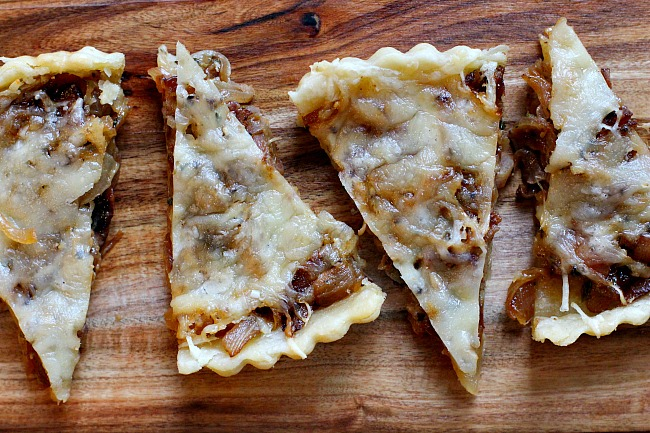 Caramelized onion tart with gruyere cheese, bacon and thyme