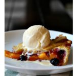 peach blueberry pie with lattice topping and ice cream